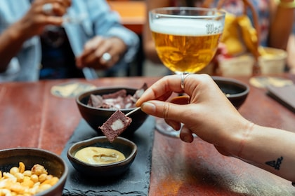 Appetizers and beer at a table in Brussels