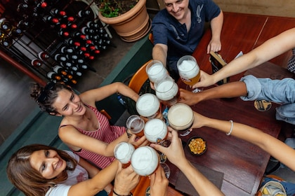 Group toasts beers at a pub in Brussels