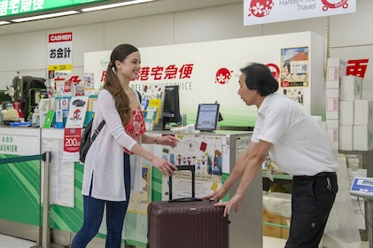 Woman using luggage delivery service in Tokyo