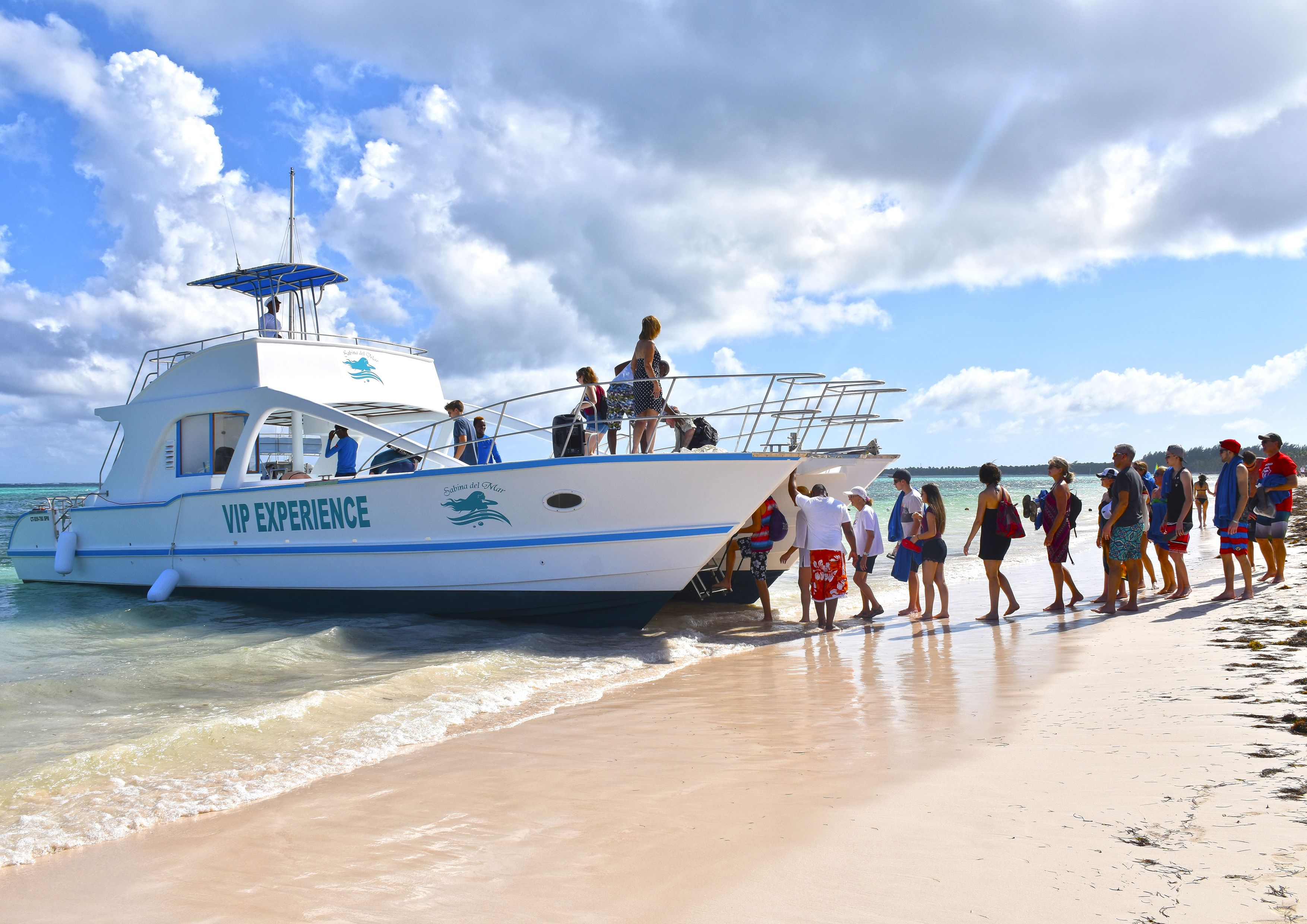 Tour group boarding a catamaran in Punta Cana
