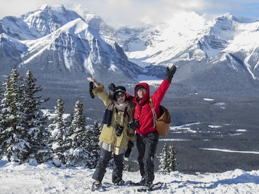Couple on a snowshoe tour of Lake Louise