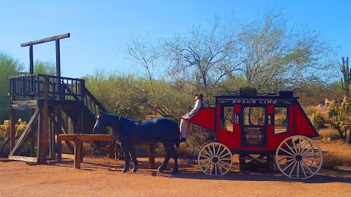Dummy sitting in a stagecoach in Apache Trail Sightseeing tour