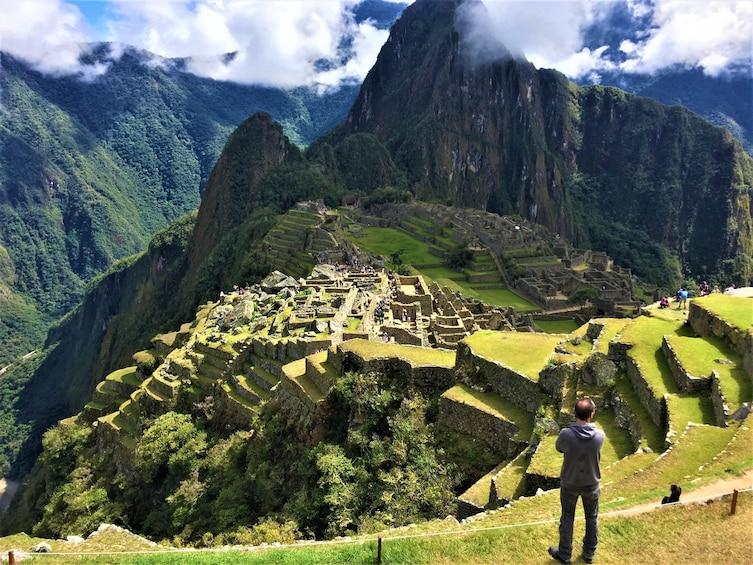 Show item 10 of 10. Man looks out over Machu Picchu in Peru