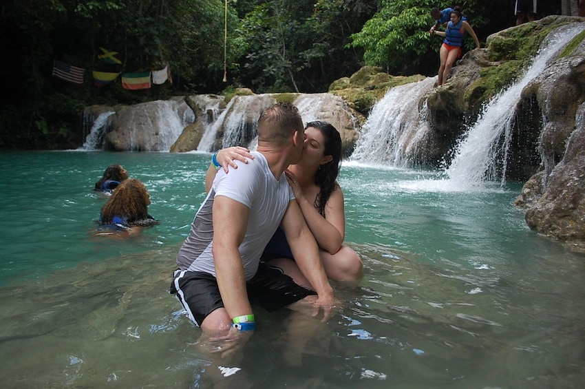 Show item 4 of 8. Couple kissing in the water in Jamaica