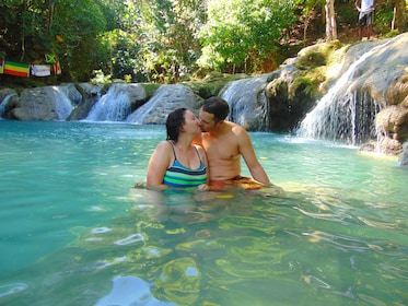 Couple kissing in the water in Jamaica