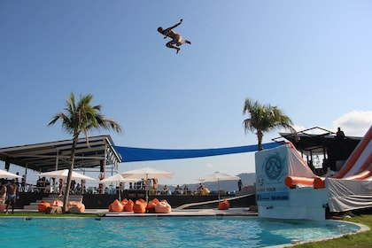 Man high in the air over a pool at High Park Samui in Thailand