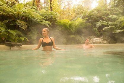 Couple relaxing in a private pool at Franz Josef Glacier Hot Pools