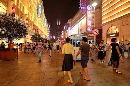 Busy pedestrian street at night in Shanghai