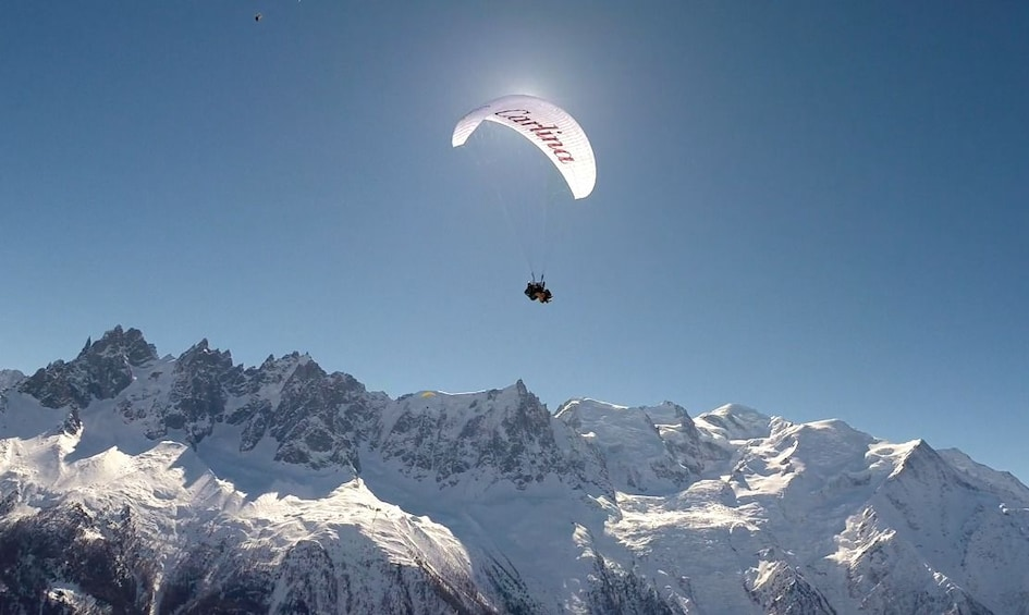 Show item 3 of 10. View of paragliders over Mont Blanc in France