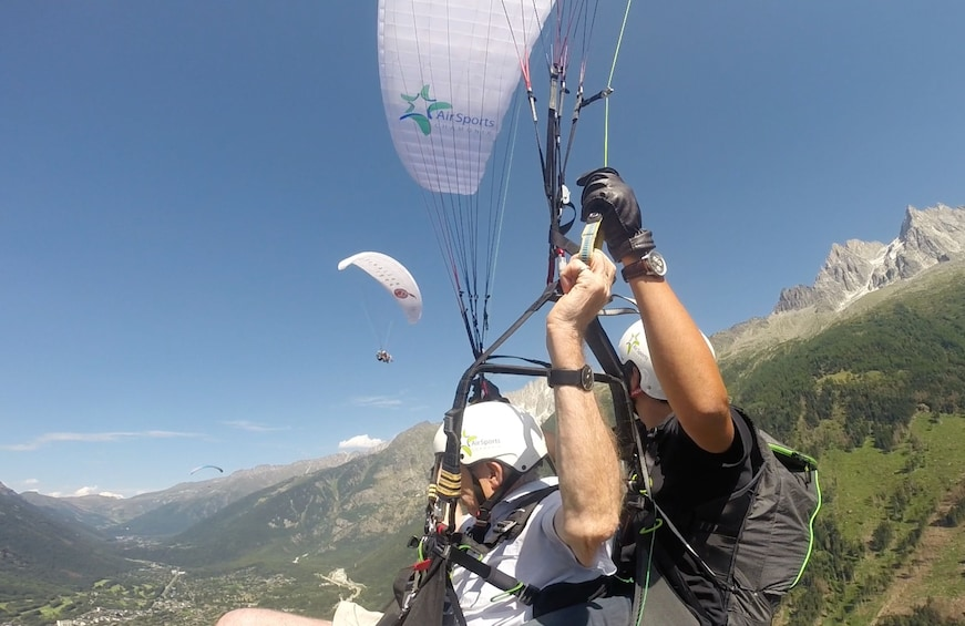 Show item 5 of 10. Closeup of paragliders over French Alps on a sunny day