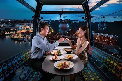 Couple enjoying a luxurious meal riding in a Cable Car in Singapore