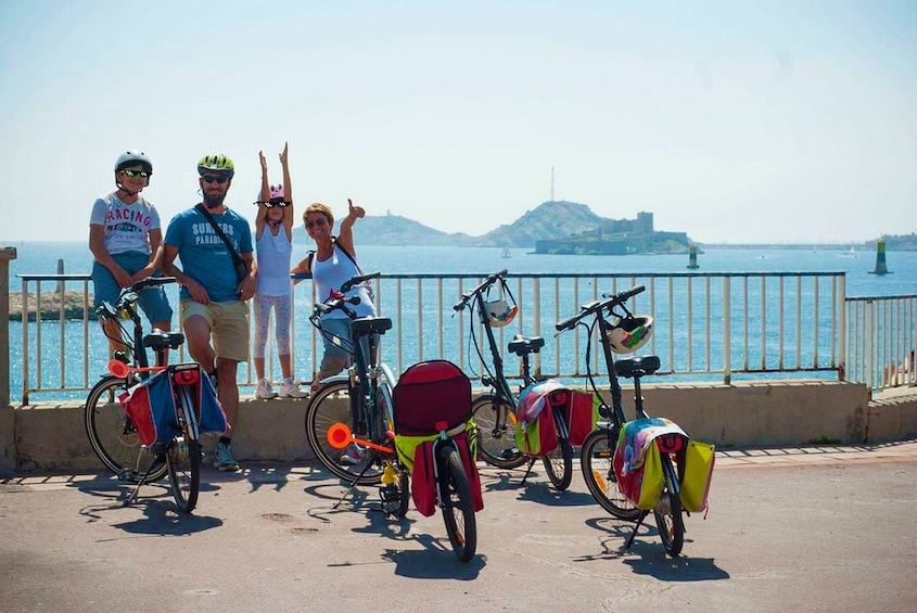 Show item 6 of 6. Bicycling family taking a break to enjoy the view in Marseille