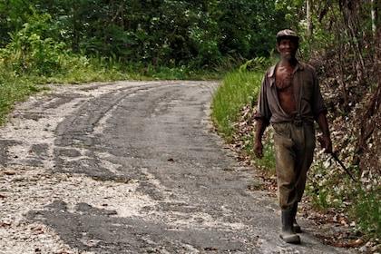 Man walking on dirt road in Jamaica