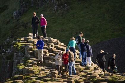 Tourists walk through the Giants Causeway
