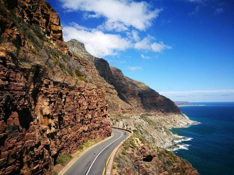 Show item 2 of 6. Coastal road and mountains in Cape Town