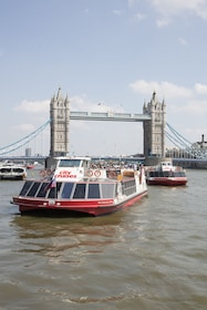 City Cruises boat on River Thames with Tower Bridge in the background
