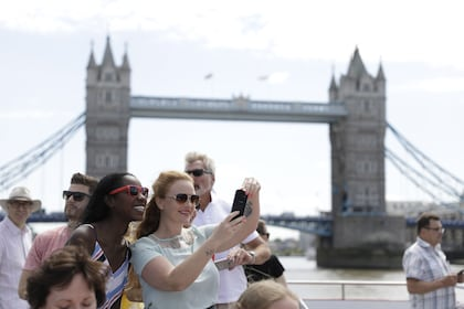 Guests enjoying a River Thames cruise aboard a City Cruises boat in London