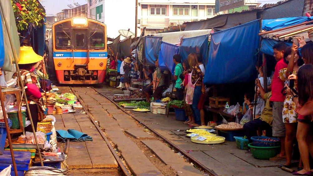 Show item 4 of 11. Train in the Maeklong Risky Market