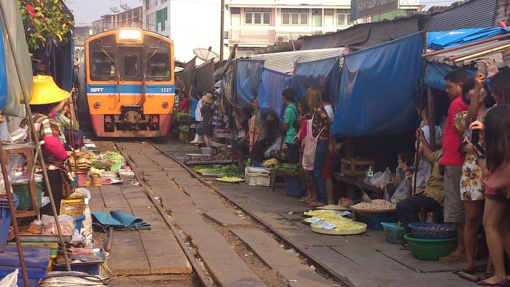 Show item 1 of 11. Maeklong Risky Market and Amphawa Weekend Market