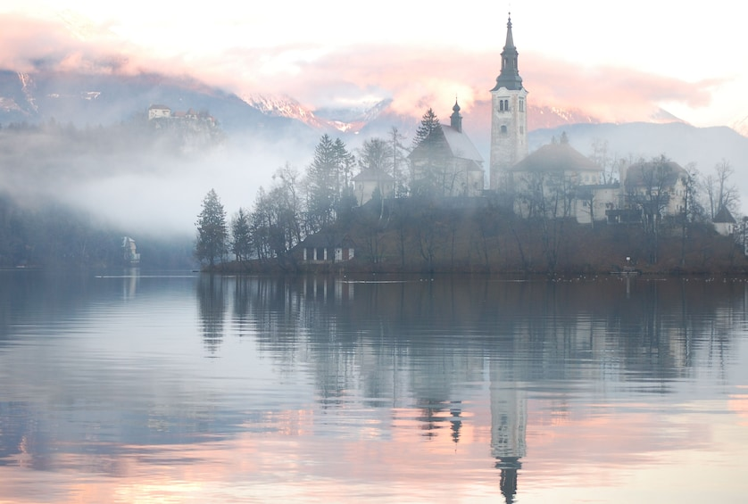 Show item 6 of 6. Lake Bled and Bled Castle on a foggy day