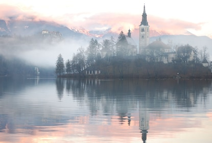 Lake Bled and Bled Castle on a foggy day