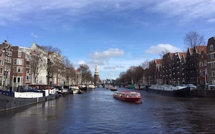 Explore Amsterdam on a walking tour + Canal Cruise