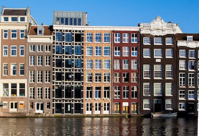 Buildings lining a canal in Amsterdam