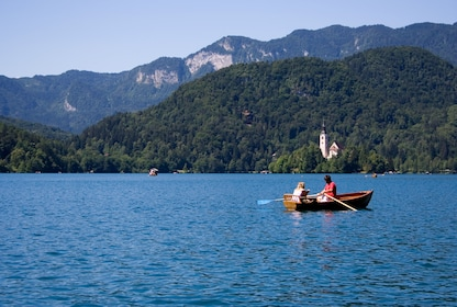 People kayaking Lake Bled