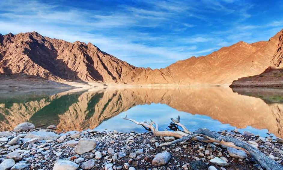 Show item 1 of 4. Hajar Mountains and lake in Dubai