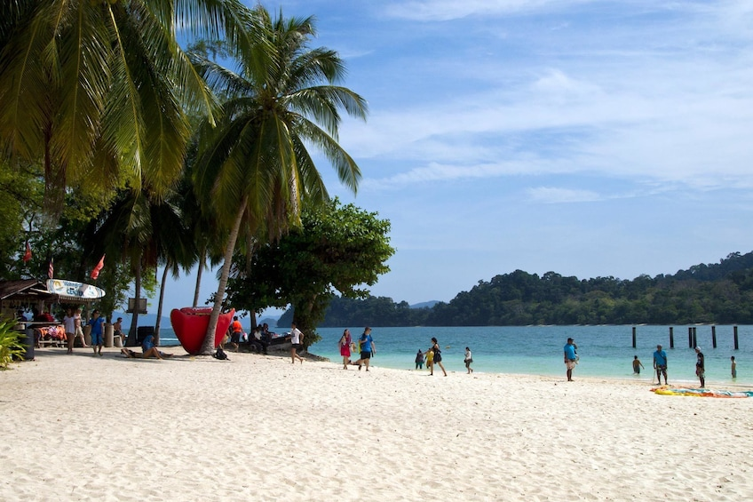 Show item 6 of 6. Tourists on a beach in Langkawi