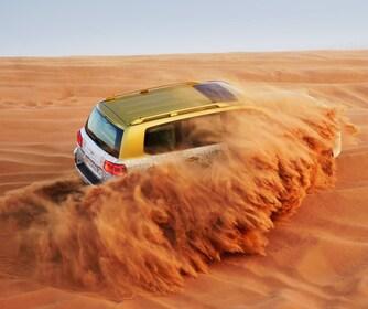 SUV driving through the desert in Dubai