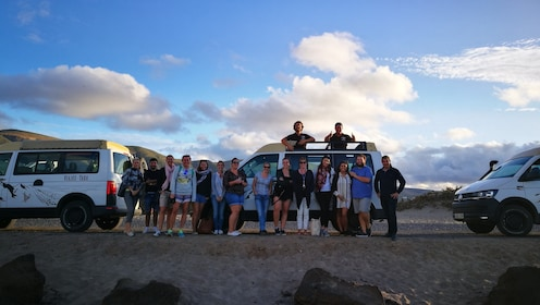 Tour group standing in front of the 4WD off-road vehicles in Lanzarote South