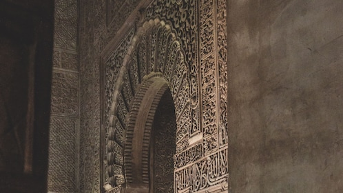 Intricately carved walls of Alhambra Palace