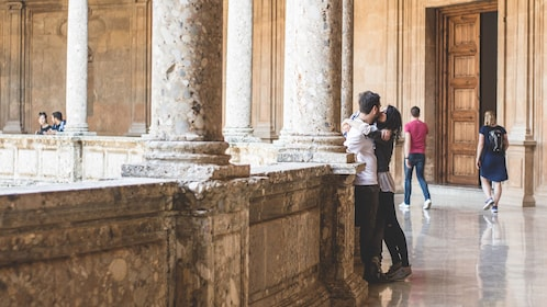 Couple kissing while touring Alhambra Palace in Granada
