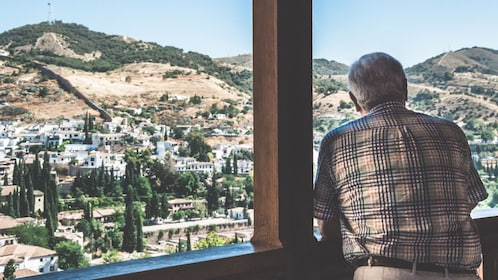 Man looking out at a view from Alhambra Palace in Granada