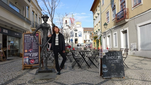 Woman posed next to a sculpture in Aveiro