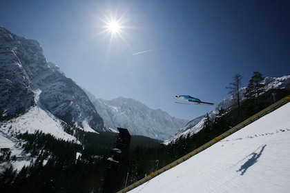 Person skis on the long jump in the Alps