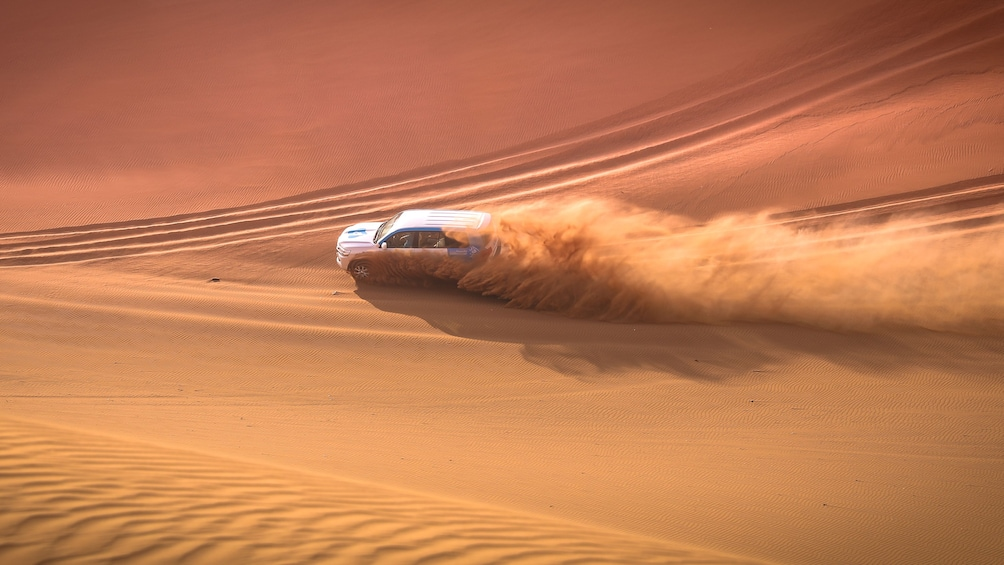 Show item 1 of 7. Jeep in the sand dunes in Doha