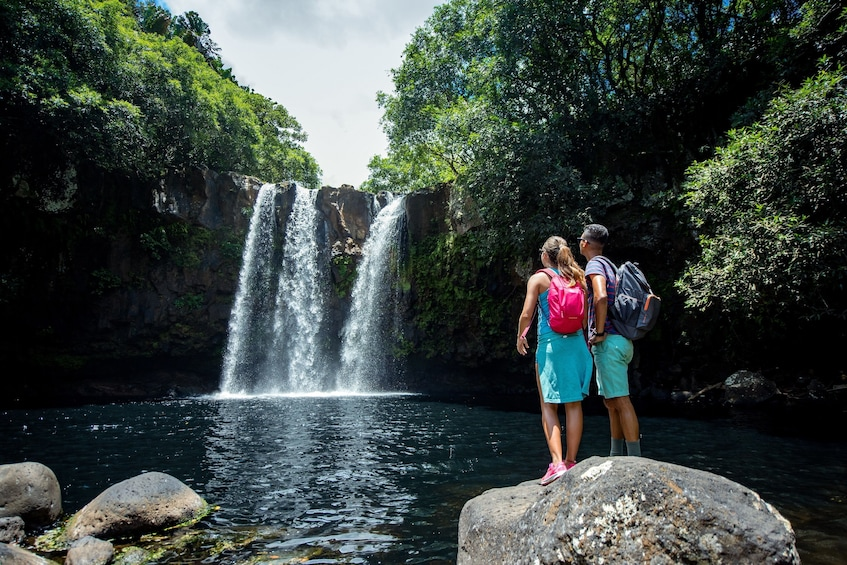 Show item 2 of 6. Couple stand on rock in front of Rochester Falls in Southern Mauritius