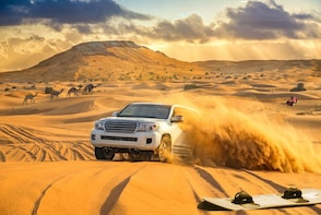 Red Dune Safari with Sand-boarding, Camel Ride & BBQ