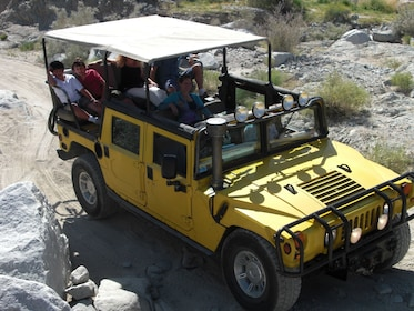 Guests aboard a real military open air Hummer touring the San Andreas Fault