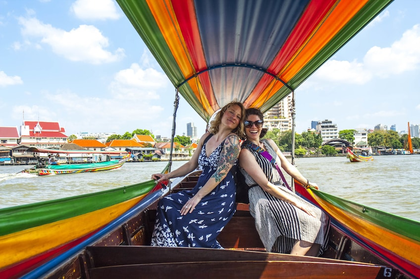 Show item 2 of 10. Couple of women on a boat in Bangkok
