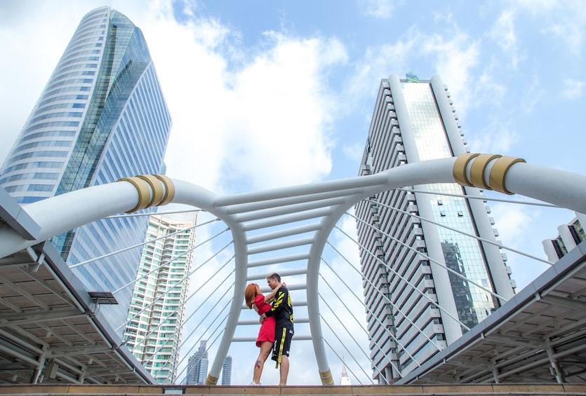 Show item 1 of 10. Couple on a bridge in Bangkok