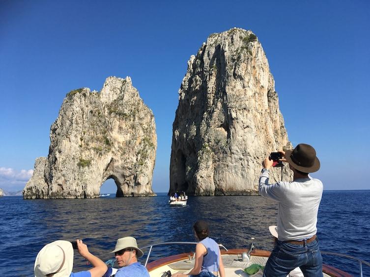 Show item 4 of 10. Faraglioni rock formations in Capri, Italy