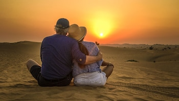 Doha: Sunset Desert Safari with Camel Ride and Sandboarding