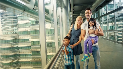 Family poses at top of Petronas Twin Towers