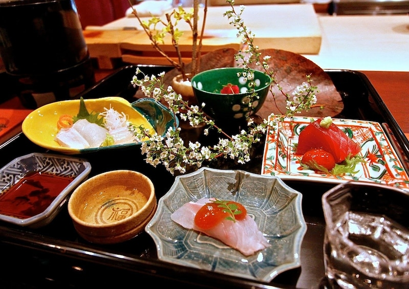 Show item 2 of 4. Colorful Japanese dishes in Osaka with flowers on a table