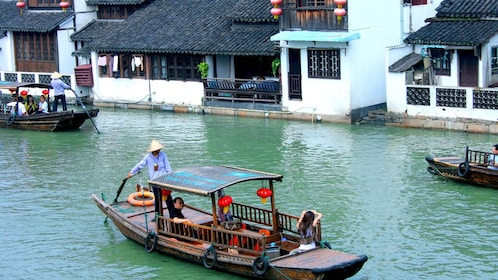 Wood boats along the canals of Fengjing Water Town