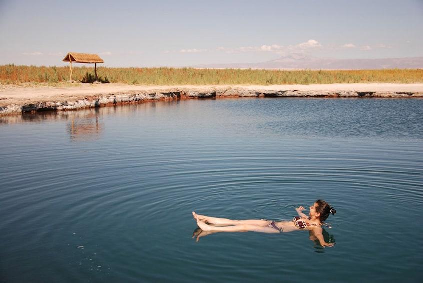 Show item 1 of 4. Woman bathing at Atacama in San Pedro de Atacama