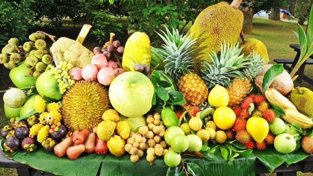 Show item 2 of 5. Table full of tropical fruits in Penang